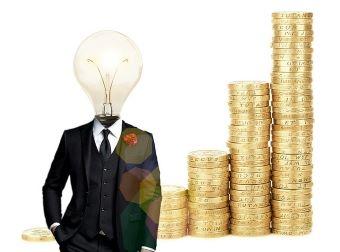 Mensch im Anzug mit Glühbirnen-Kopf. Im Hintergrund: München , die einen steigenden Graph darstellen